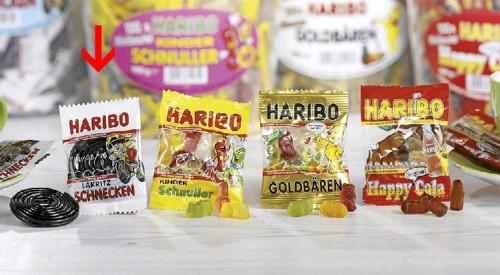 Haribo Lakritz Schnecken,  Inhalt: 100 Minibeutel à 10 g je Runddose.